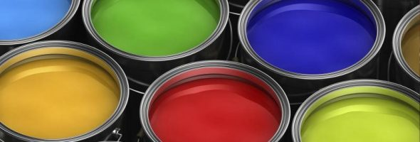 Разноцветные краски в жестяных банках