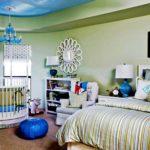 Кроватка круглой формы в спальне оливково-голубых тонов