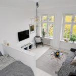 Двухуровневая гостиная-спальня в скандинавском стиле